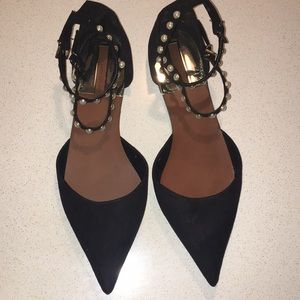 Black pointed toe flats with faux pearls